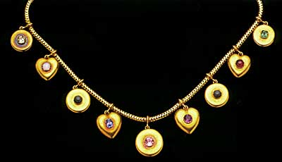 Victorian 18ct gold necklace with five round and four heart-shaped pendants each set with a central gemstone, the initial letters of each spelling the name 'Constance': citrine, opal, nephrite, sapphire, tou rmaline, amethyst, nephrite, cabochon (garnet) and emerald. Anne Schofield Antiques, Sydney