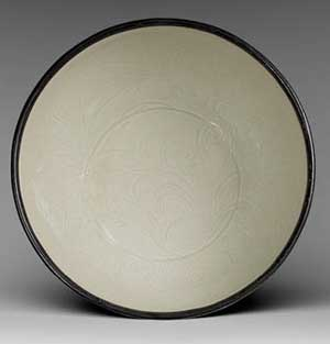 Ding Ware Northern Song Dynasty - The unobtrusive decoration is of incised lotus and sagittaria sprays that is incised into the body that has been ennobled by a mellow ivory-white glaze and the rim is protected by a metal cap 11th - 12th century