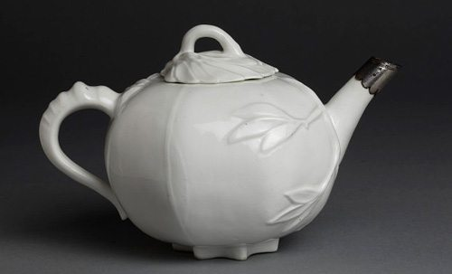 Bottger brilliance; superb Meissen white porcelain teapot with applied leaf decoration and a silver mount