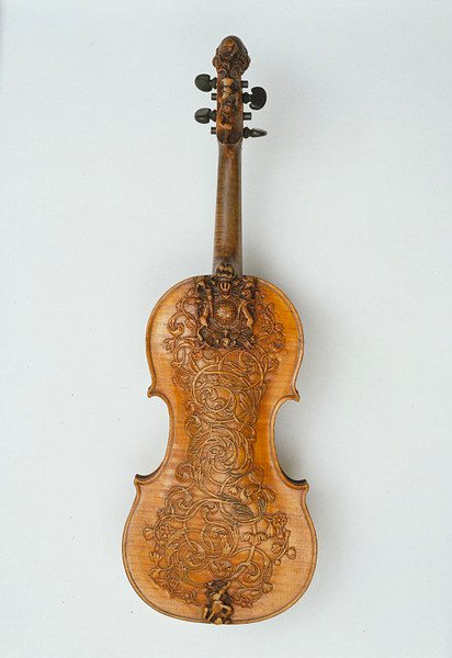 Attributed to Maker Ralph Agutter 1685 this beautiful violin is carved, sawn and planed sycamore and pine. Made for the Royal Household it includes the Royal Stuart coat of arms before they were modified at the time of the accession of William III and Queen Mary in 1688