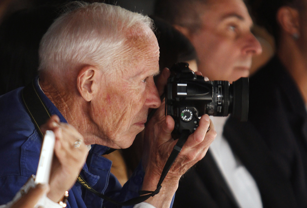 New York Times photographer Bill Cunningham takes photos during the Naeem Khan Spring/Summer 2013 collection show at New York Fashion Week