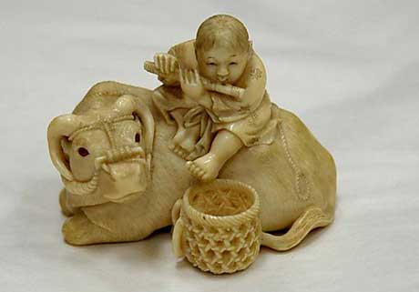 Ox-&-Baby-playing-Flute-Netsuke