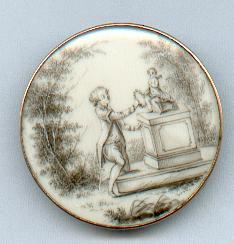 18th century Ivory button with ink image of a boy at a pedestal courtesy British button society