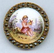19th Century - Enamel with cut steel -cherub and bird button, courtesy British Button society