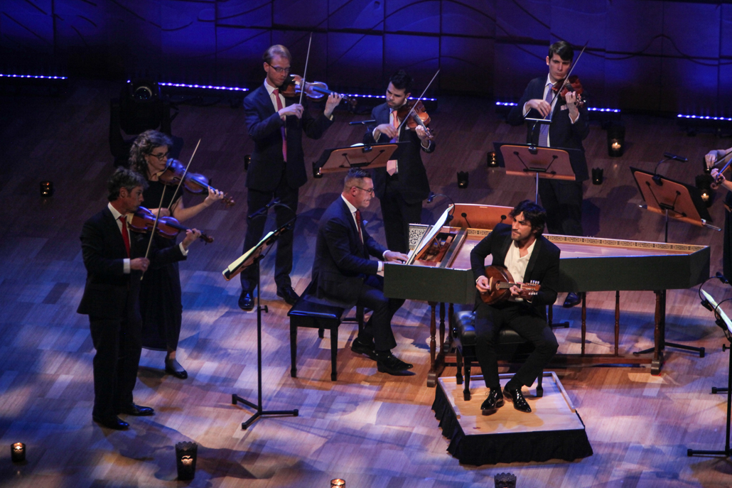 Avi Avital on stage with musicians of the Australian Brandenburg Orchestra, photo by Steven Godbee