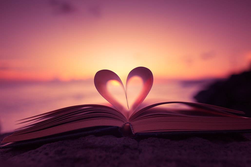 Heart shape paper book on the beach