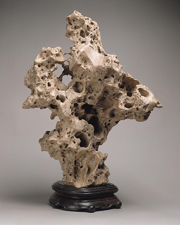 Scholar's Rock, Qing dynasty (1644 - 1911), 19th century, Taihu limestone, wooden stand, Gift or Richard Rosenbaum Family,  courtesy The Metropolitan Museum of Art, New York
